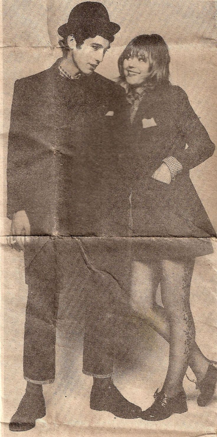This (at the time) 17 year old Smooth from North London is wearing a made to measure Crombie and a trilby, Levi's, a Ben Sherman shirt and Oxfords. The girl was a model and has on a petrol blue/gold Trevira suit. A lot of the gear came from High Street stores like Burton and Top Shop.