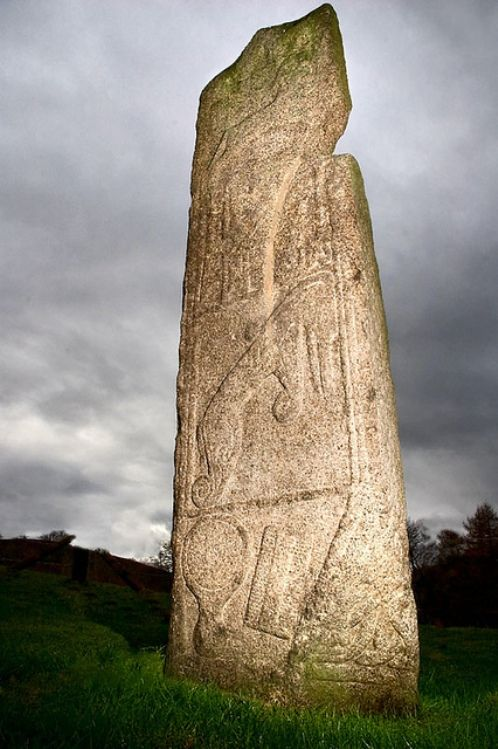 The Maiden Stone, a Pictish standing stone near Inverurie in Aberdeenshire, Scotland (circa 8th century AD). Local legend states the daughter of the Laird of Balquhain made a bet with a stranger that she could bake a bannock faster than he could build a road to the top of Bennachie. The prize would be her hand. The stranger was the devil.  The maiden lost the bet, and God turned her to stone.  The notch in the rock is where the devil grasped her shoulder as she ran from him.