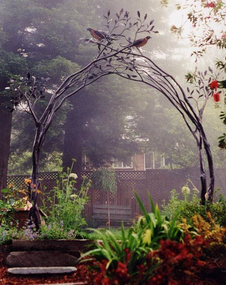 Tree branch trellis arch by Shawn Lovell Metalworks. More practical than the wooden arbor that always needs painting.