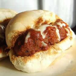 Hearty Meatball Sandwich   Easy version- frozen meatballs in spagetti sauce, hoagie rolls and cheese.  More difficult version at Allrecipes.com