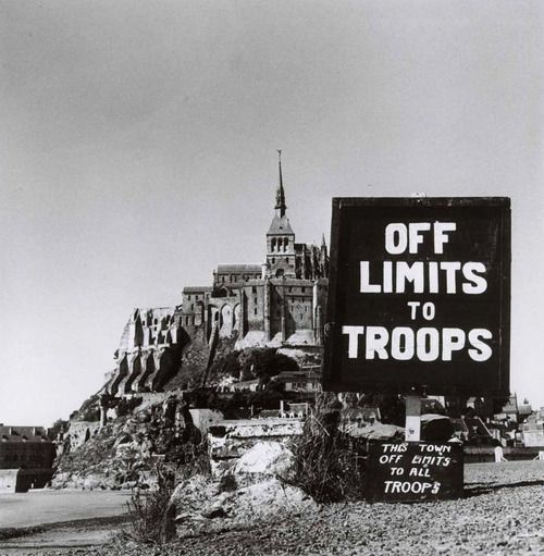 Off Limits To Troops. Mont Saint-Michel, Normandy, August 1944. Photograph by Robert Capa.
