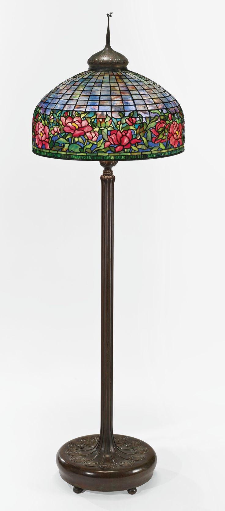 "Tiffany Studios ""PEONY BORDER"" FLOOR LAMP with a ""Scroll"" Senior floor base and ""Pig Tail"" finial shade impressed TIFFANY STUDIOS NEW YORK base impressed TIFFANY STUDIOS/NEW YORK/375 leaded glass and patinated bronze circa 1910 77 1/8  in. (195.9 cm) high 