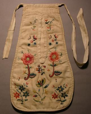 Early to mid 1700s pocket. The front of this pocket is made of twill weave linen and also lined with linen. It is embroidered in colourful wools in flowers, stems and leaves. The back is made of plain weave linen. The tapes are made of linen and form part of the pocket top.