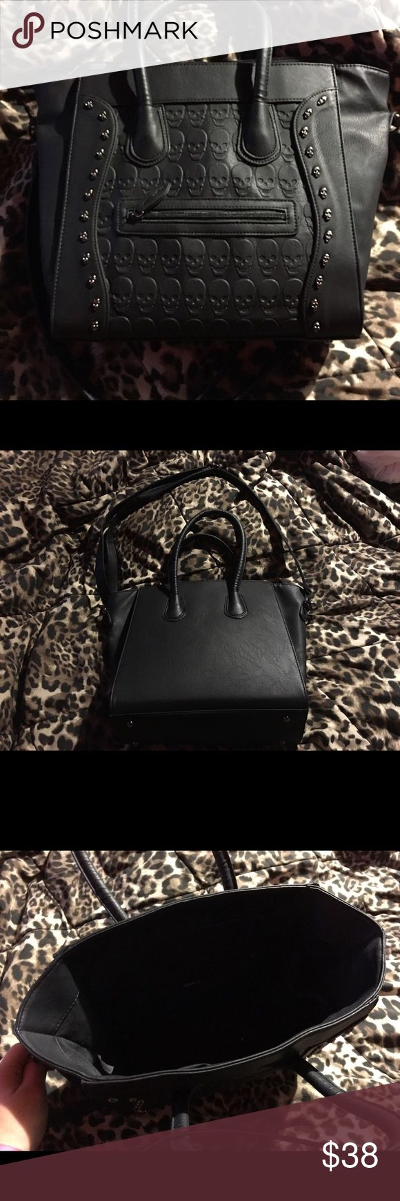 Torrid Skull Purse Black handbag with skull details. Has a handle and a shoulder strap. One big pocket with smaller pockets on the inside and one small pocket on the outside. torrid Bags Totes