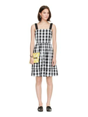 made from a black-and-white large-format gingham that's a bit more versatile than classic version--yet every bit as picnic-friendly--this dress is a summer must-have.