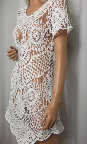 Sukieneczka zrobiona ręcznie na szydełku z włóczki 100% bawełna w kolorze białym.Doskonała na lato,na plażę,na imprezę.Rozmiar 40,