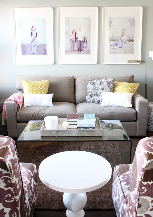 Small family room layout. Love the large white frames over the love seat.
