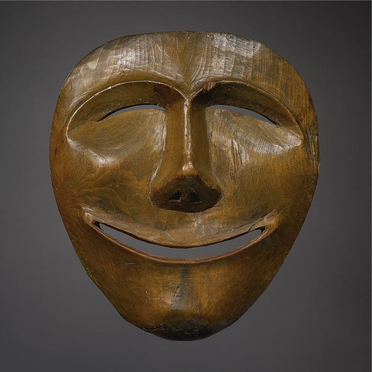 AN ESKIMO WOOD MASK, POINT HOPE    composed of carved wood,depicting the moon.