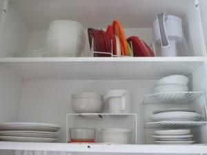 We use small kitchen shelves to organize our bowls and plates, and a desk organizer (seen on the top shelf in the picture) to organize our Tupperware lids. Tips for Organizing Your First Apartment | Ohio State News