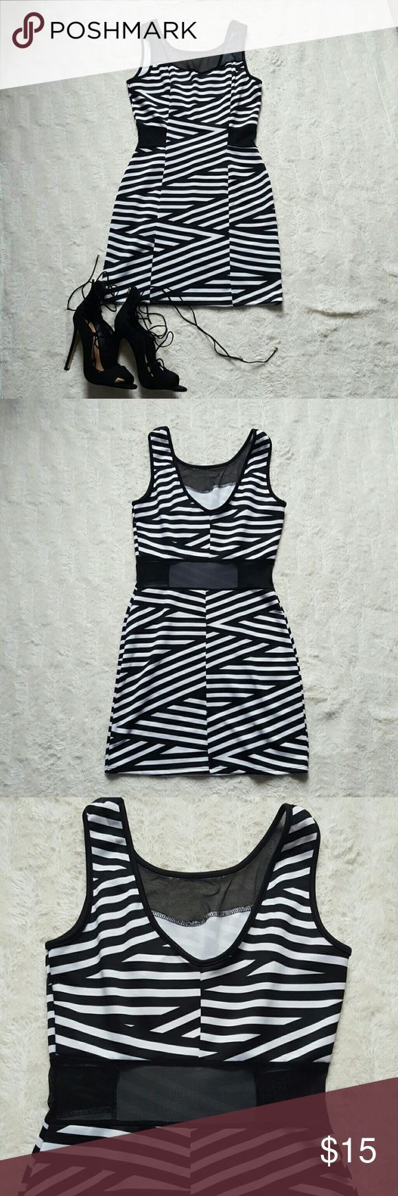 Body Central dress with black mesh cutouts Brand new NEVER worn!! Black and white stripped mini dress with mesh cutouts. Super cute on just not my size. Body Central Dresses Mini