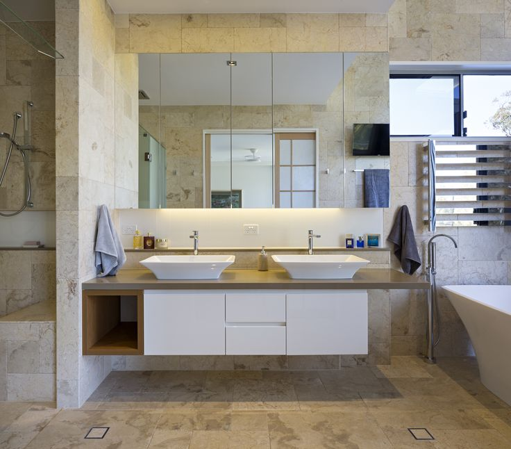 The Golf House // Caesarstone Cashmere bathroom bench tops and a beautiful free-standing bath // By Studio 15b Architecture + Interior Design. Navlam Sandblasted™ Teak joinery.