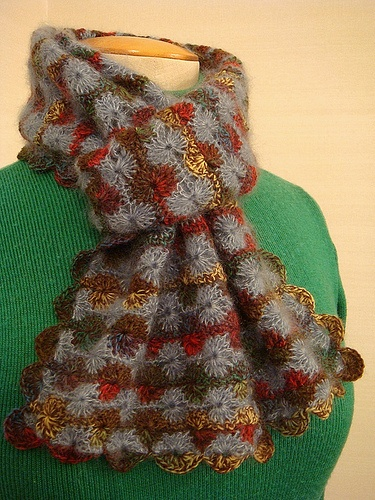 Catherine Wheel stitch scarf, knotted by craftyknitter, love the colors!