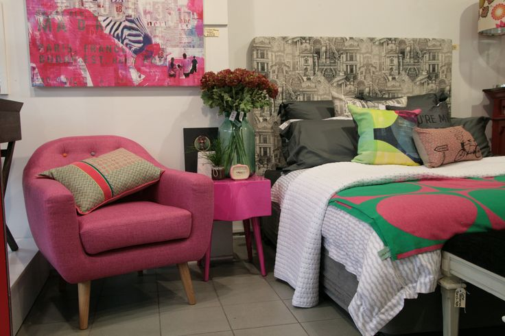 Design Art House custom made bed head styled in store with pink as an accent colour.  Bed head features architectural fabric exclusive to Design Art House.