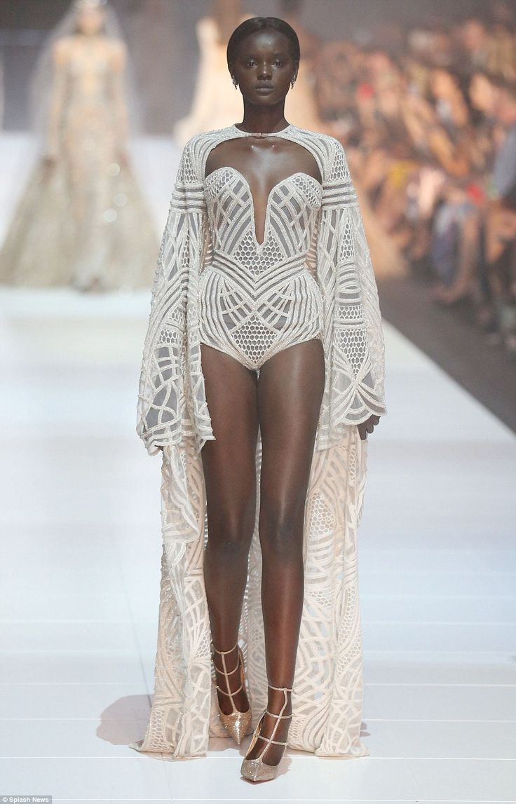 Bridal bodysuits:Another ensured all eyes were on her when she stepped out in a form-fitting cream bodysuit slashed with shimmering sheer panels and and a dramatic plunging neckline