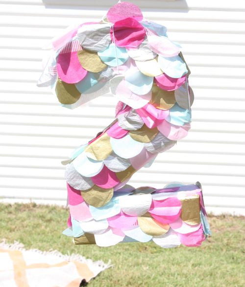 confetti party pinata - covered in tissue paper circles // the happy home blog