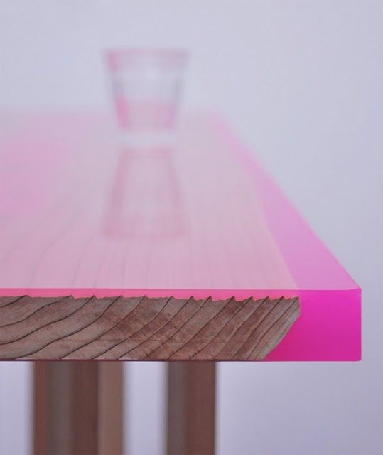 wooden table top finished with a layer of colored epoxy resin