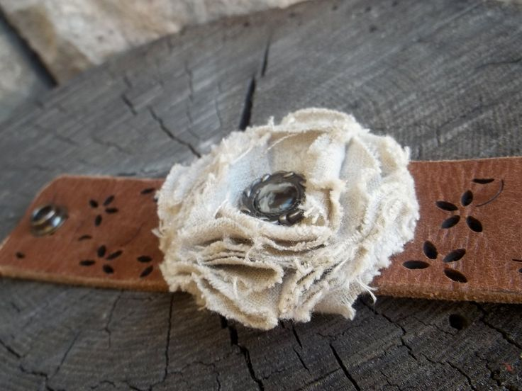 Leather cuff with off white linen flower