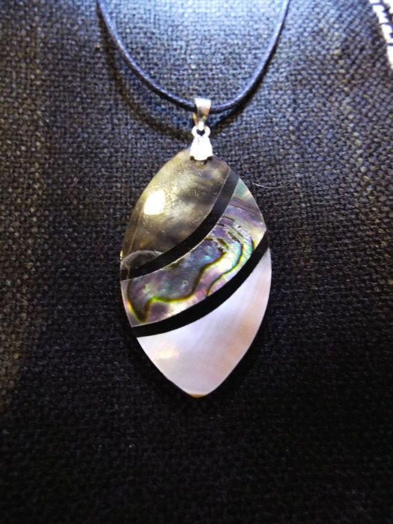 Handmade Abalone seashell pendant with shimmery effects.