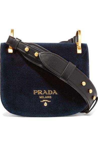 Prada's 'Pionnière' bag is reworked in plush midnight-blue velvet for spring - a chic choice for every day or evenings out. Originally inspired by hunting styles, this compact piece has a gently curved silhouette and burnished gold hardware. Carry yours in-hand or by the optional leather strap.