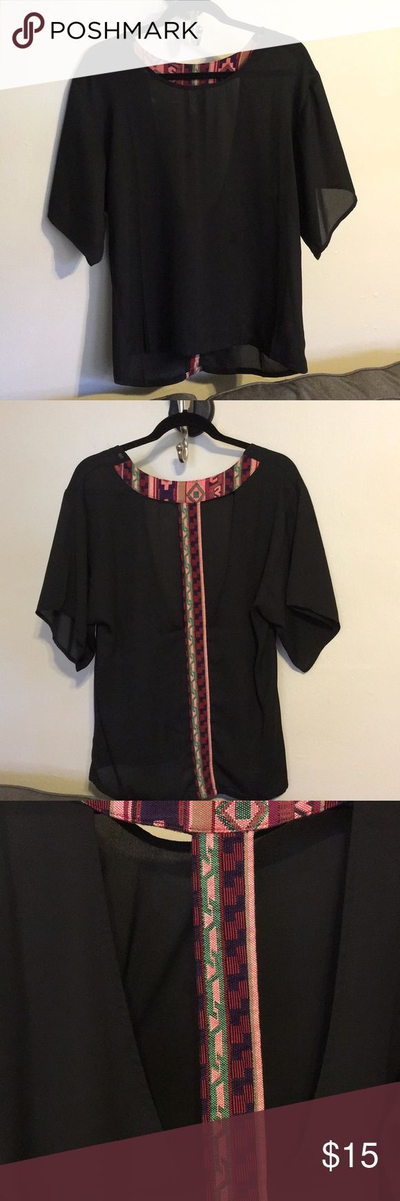Black blouse Black thin blouse, flowy t shirt sleeves, open back with Aztec design. Worn once. Francesca's Collections Tops Blouses