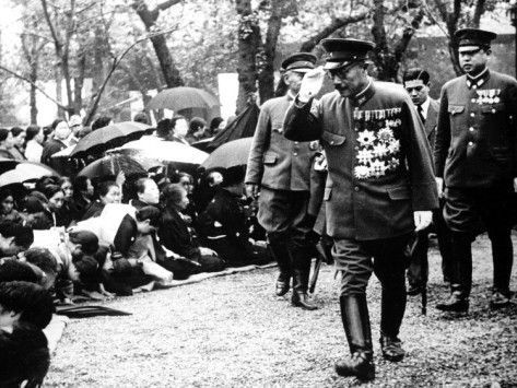 This is an undated photo showing War Minister General Hideki Tojo, premier designate of Japan, during his visit at the Yasukuni Memorial Shrine in Tokyo to pay homage to the Spirits of the 15,013 war dead enshrined on Oct. 16, 1944
