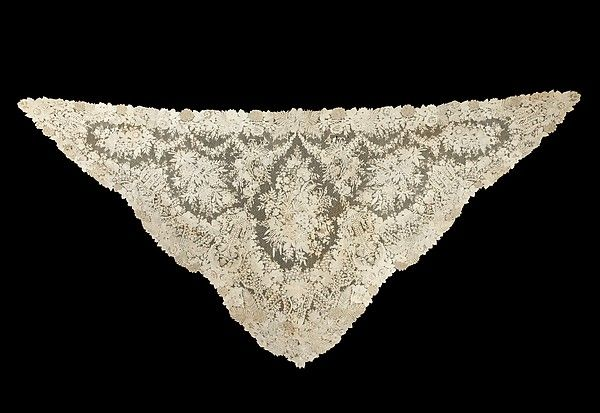 The high quality of this Brussels needle lace shawl is displayed not only in the fine workmanship but also in the complexity of its design. The variety of motifs includes a number of different types of flowers