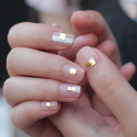 minimalist sheer nails with gold rectangles