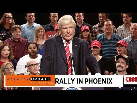 """Baldwin's Trump took the stage at thePhoenix rallyidentifying himself as the """"tragic victim"""" after Charlottesville due to the media """"reporting my entire remarks, even the bad ones.""""  He also bragged about the fact he """"solved Afghanistan"""" and brought onstage the president's former chief strategist """"Steve Bannon"""" (dressed as the Grim Reaper) for a """"proper goodbye."""" (Click on """"Visit"""" and then on play for HILARIOUS video)"""