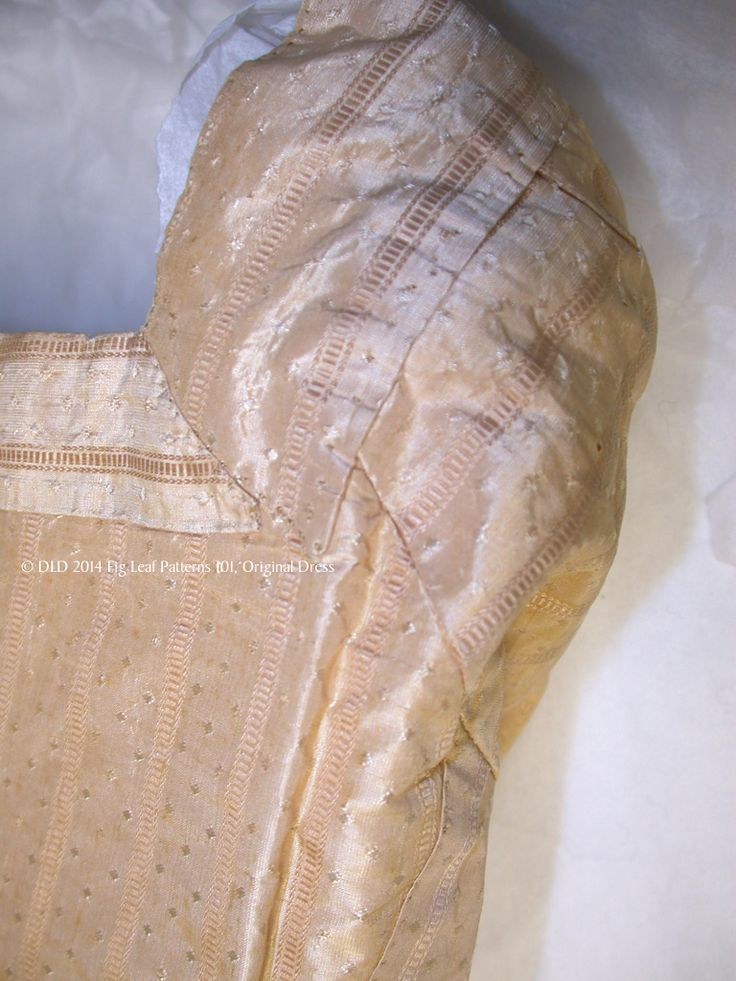 Shows the stitches and shape of the back facing of the original gown from the Sumter County Museum, SC.