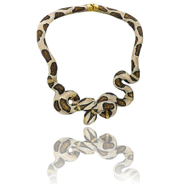 The serpent is the ultimate symbol of temptation and desire. This beautiful brass necklace is hand enameled and plated with 18K gold and will for sure make your look both luring and attractive.