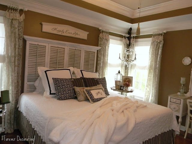 Cozy Country Bedroom with low moldings and Shutter Headboard embellished with molding~Homemade pillow possibly~from:Best Headboard Alternatives :: Hometalk;
