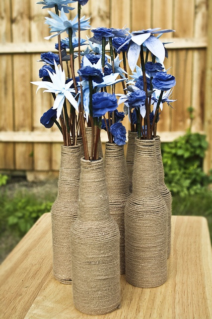 These yarn vases were super easy to make and very inexpensive simply