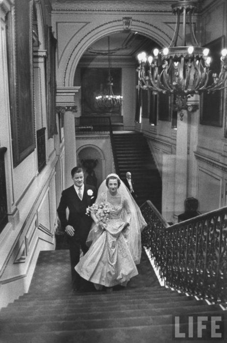 """Diana's parents on their wedding day, of which 9 members of the Royal family attended including the late Queen Mum and present Queen.  Bride, 18 year old Frances Roche, wore the Spencer tiara to marry 30 year old Viscount """"Johnnie"""" Spencer, heir to the Althrop earldom.  Frances was the youngest bride to be married at Westminster since the turn of the century and one of only a privileged few allowed to marry each year in the Abbey. In 1954, it was described as the wedding of the year."""