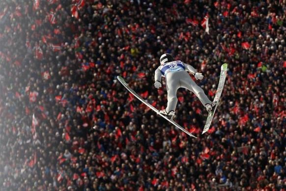 Norway's Anders Fannemel soars through the air during the first round of the Ski-Flying World Championships in Vikersund February 25, 2012.  REUTERS/Leonhard Foeger