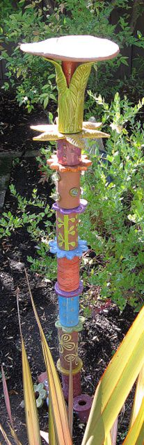 garden totem of ceramics, wonder if something similar could be done with decorated tin can...?