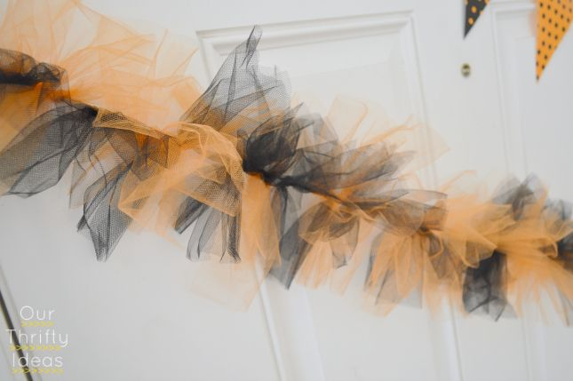 "Easy Halloween bunting from ribbon and 6"" strips of tulle (double knot around ribbon). Could use any colors for any holiday or event."