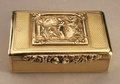 """Leopard Antiques Silver Boxes and Vinaigrettes A magnificent silver gilt snuffbox, with a cast panel of a scene from Greek mythology, showing Hebe, Goddess of Youth, feeding Jupiter (disguised as an eagle) with Ambrosia, the nectar of eternal youth. Hebe, or Juventas in Latin, was the cup bearer to the Gods, responsible for feeding them """"Heavens Wine"""" to provide immortality. The box is engine turned, and has a flower head thumb pull. This box is of outstanding quality,.... Antique Silver"""