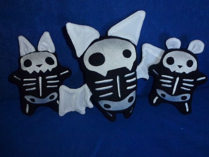 Skelly plushies. cat, bat and bear. In the hoop embroidery pattern from Urban threads. here is the link http://www.urbanthreads.com