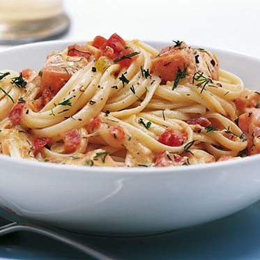 Pasta with a Salmon-Tomato-Sour Cream sauce topped with fresh dill.
