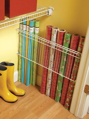 Storing gift wrap with wire closet shelving - like this idea, but there might be a cheaper solution.  Don't know that we have a shelf the right size.  What about a shower rod?  You could also string a bungee cord with ribbon spoils and hook on the shelf.