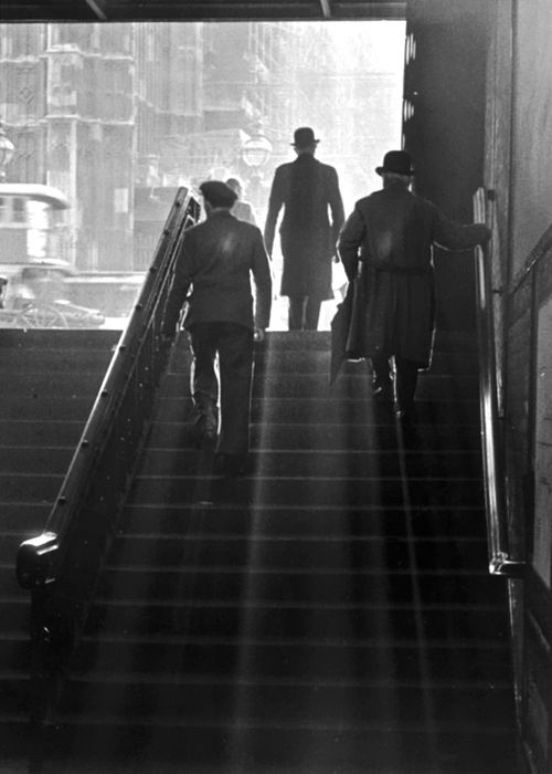 Commuters walking up the steep steps leading out of Westminster underground station, central London, England, 1930s. photographer unknown.