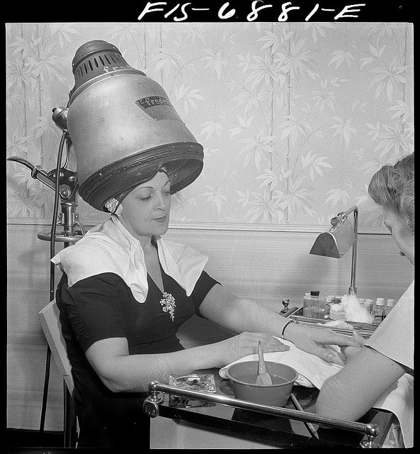 New York, New York. Getting a manicure while drying hair at Francois de Paris, a hairdresser on Eighth Street 1942 Sept.