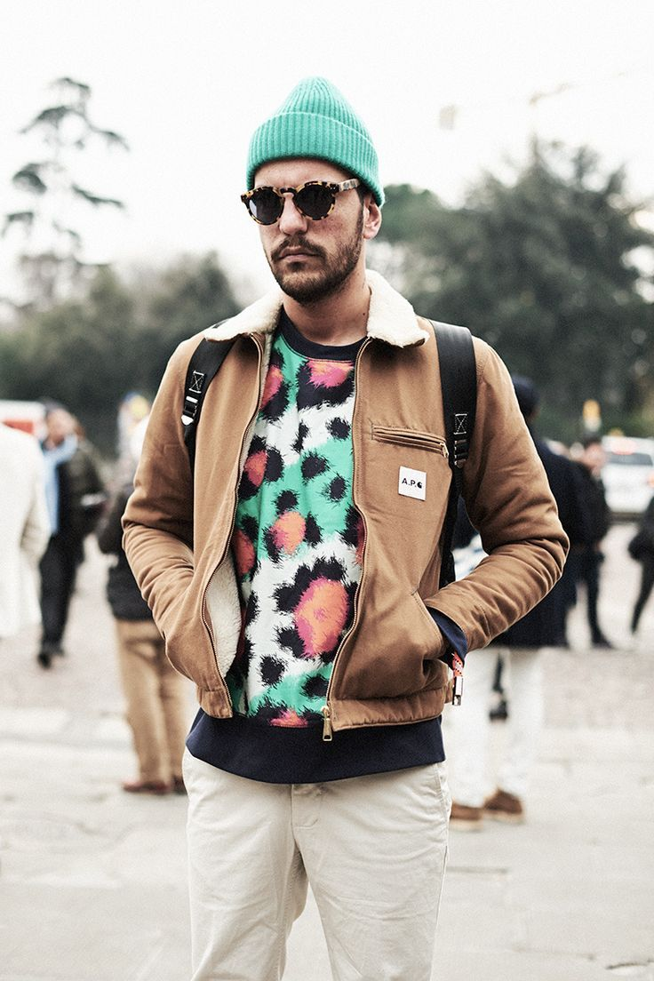 Shop this look for $122:  http://lookastic.com/men/looks/multi-colored-crew-neck-sweater-and-brown-bomber-jacket-and-white-chinos-and-mint-beanie/1369  — Multi colored Leopard Crew-neck Sweater  — Brown Bomber Jacket  — White Chinos  — Mint Beanie