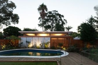 A view of the granny flat and curved pool