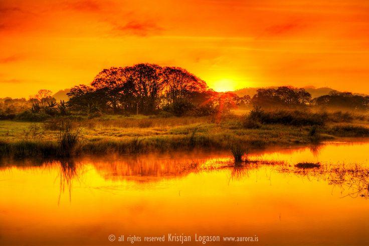 Morning glow on Lake Yojoa, Honduras..Lake Yojoa is the largest lake in Honduras with a surface area of 285 square kilometers (110mi²) and ...
