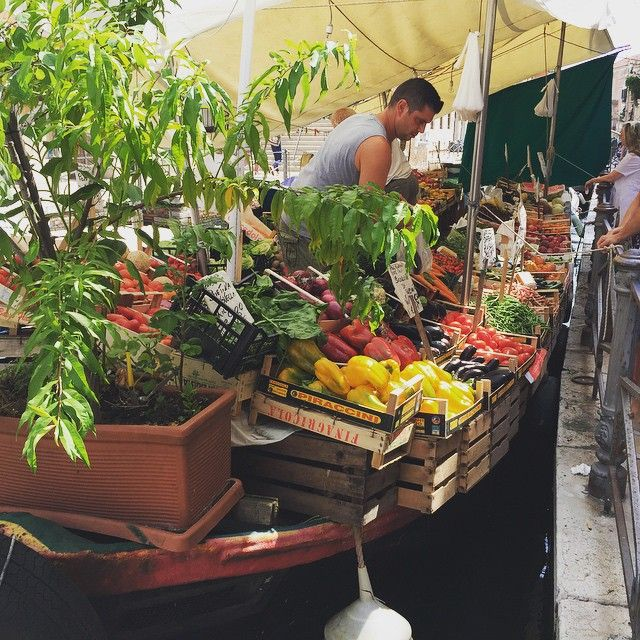 Floating vendor, fresh vegetables, fabulous Venice. Yes, packed with tourists but it's easy to find quiet alleys and local life a couple of turns off the main streets and waterways. Venice Biennale