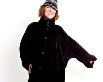 Another version of the long fleece poncho, this time without the hood. Stylish, warm a treat on a cold day.