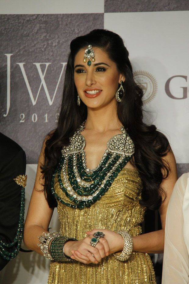 Nargis F show-casing stunning jewelry made of emerald stones, kundan, white gold and diamonds<3