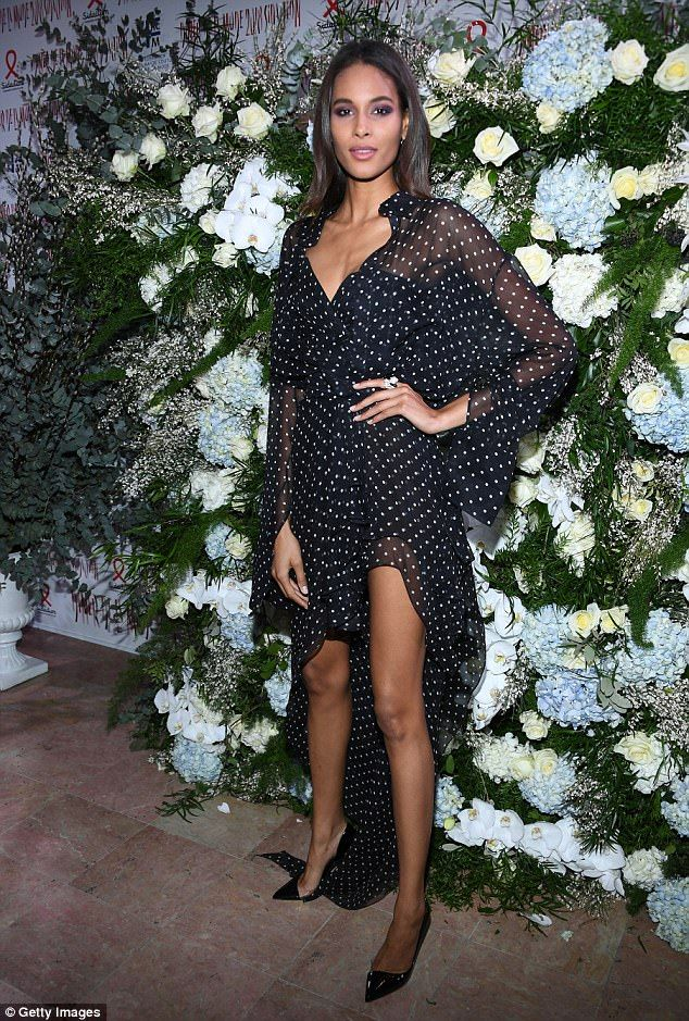 Leggy lady! The French model dazzled in a sheer polka dot gown that offered a look at the ...