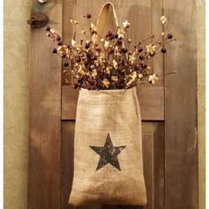 Prim Burlap Sack...with a star & stuffed with berries.